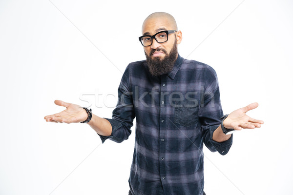 Young afro american man shrugging shoulders Stock photo © deandrobot