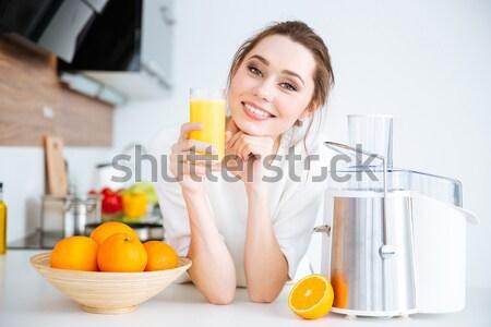 Vrolijk vrouw tonen half oranje vergadering Stockfoto © deandrobot