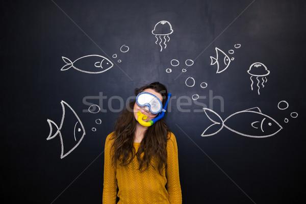 Pretty woman diving maschera lavagna subacquea mondo Foto d'archivio © deandrobot