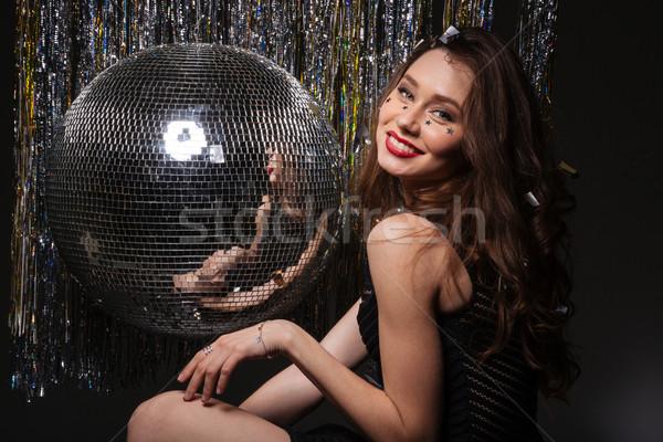 Mooie glimlachende vrouw poseren disco ball glimlachend Stockfoto © deandrobot