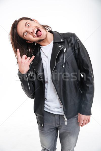 Crazy giovane lingua rock gesto Foto d'archivio © deandrobot