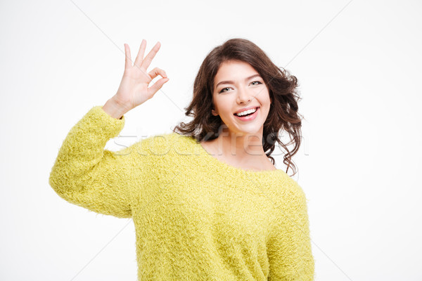 Portrait of a happy woman showing ok sign Stock photo © deandrobot