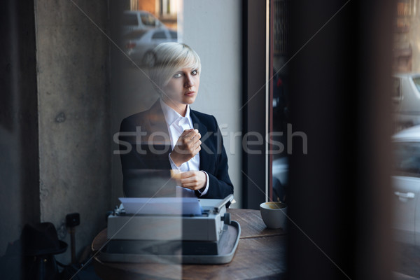 Beautiful blonde girl sitting in cafe Stock photo © deandrobot