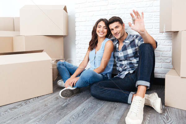 Young couple with boxes and flat keys Stock photo © deandrobot