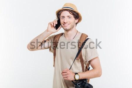 Fiatal mosolyog fickó készít telefonbeszélgetés tart Stock fotó © deandrobot