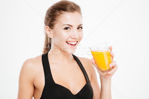 Vrolijk glimlachende vrouw glas sinaasappelsap portret Stockfoto © deandrobot