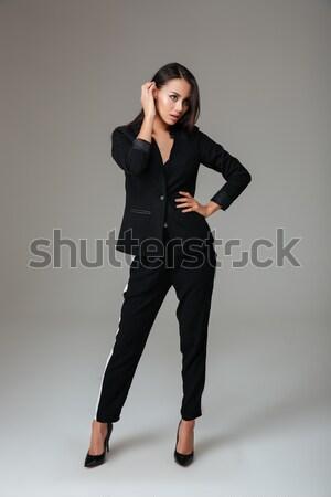 Portre ciddi esmer kadın siyah takım elbise poz Stok fotoğraf © deandrobot
