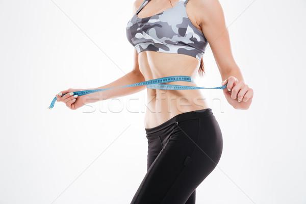 Portrait femme mètre à ruban studio isolé blanche Photo stock © deandrobot