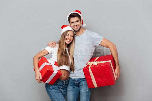 Güzel çift Noel sürpriz eller Stok fotoğraf © deandrobot