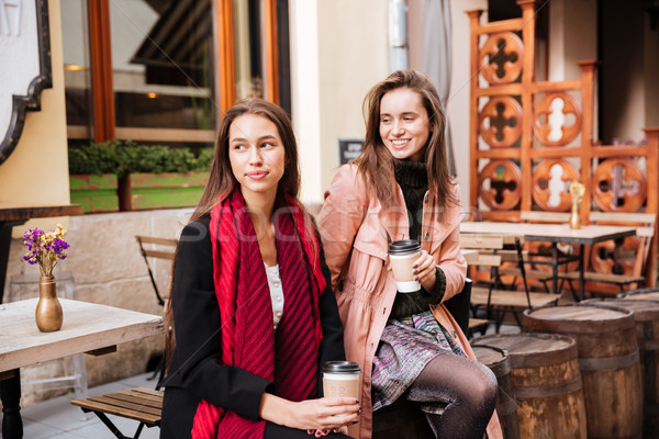 Two models in coats are sitting Stock photo © deandrobot
