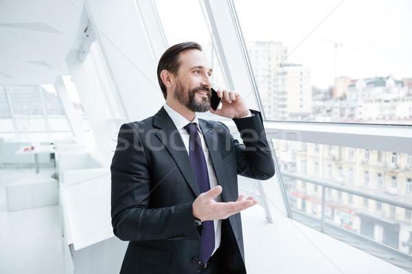 пожилого бородатый деловой человек говорить телефон окна Сток-фото © deandrobot
