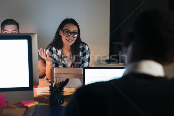 Derűs üzletemberek dolgozik késő éjszaka iroda Stock fotó © deandrobot