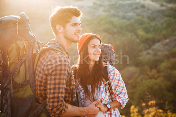Two tourists on slope in profile Stock photo © deandrobot