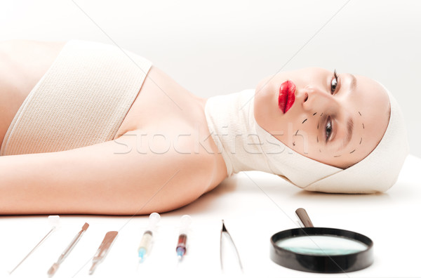 Girl in bandages lying Stock photo © deandrobot