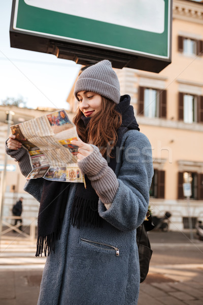Woman tourist using map on the street of city Stock photo © deandrobot