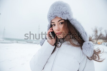 Amazing young lady wearing hat walking at cold winter day Stock photo © deandrobot