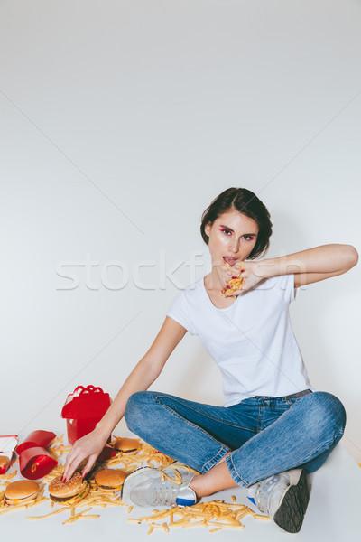 радостный женщину еды картофель фри Burger таблице Сток-фото © deandrobot