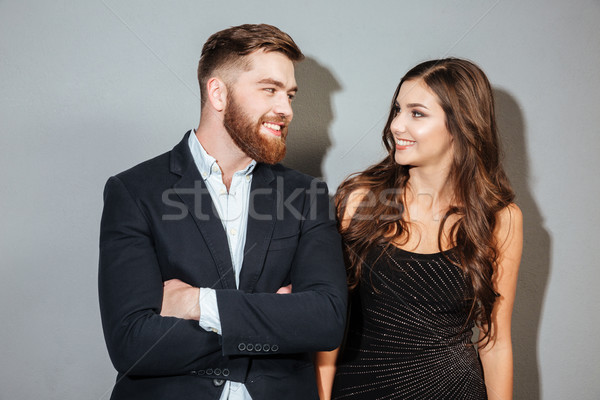 Happy smiling couple in formal wear looking at each other Stock photo © deandrobot