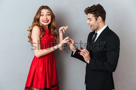 Funny couple with champagne Stock photo © deandrobot