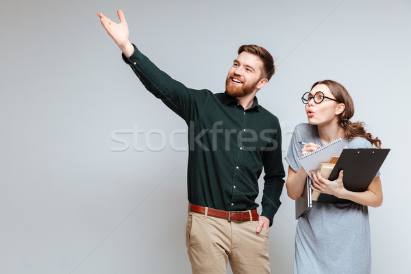 Bearded man showing something for Female nerd Stock photo © deandrobot