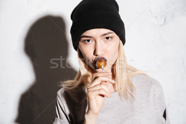 Close up portrait of Cool Hipster woman in black hat Stock photo © deandrobot