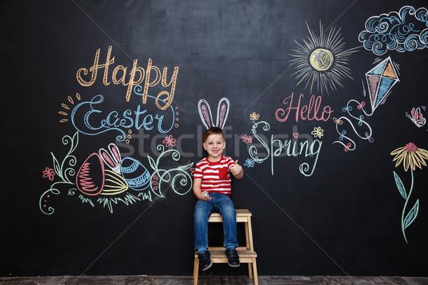 Glimlachend cute weinig jongen Easter Bunny oren Stockfoto © deandrobot