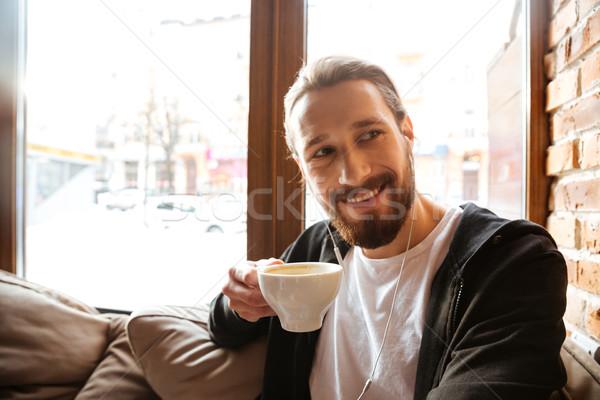 笑みを浮かべて あごひげを生やした 男 カフェ ウィンドウ 座って ストックフォト © deandrobot