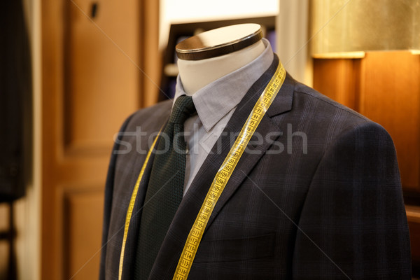 Close up shot of men suit and tie hanging in wardrobe Stock photo © deandrobot