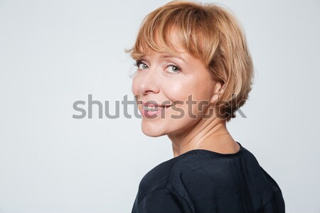 Close up image of elderly woman standing sideways Stock photo © deandrobot