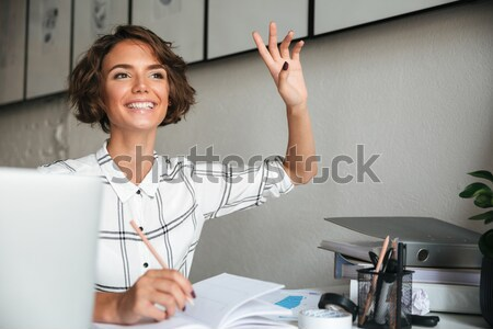 Attractive female designer creating new clothes Stock photo © deandrobot