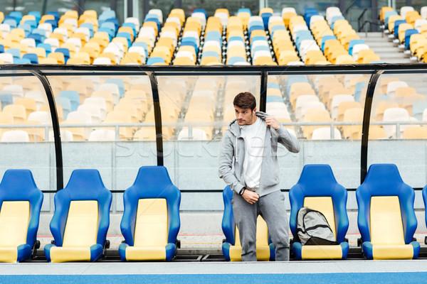 концентрированный молодые спортивных человека стадион фотография Сток-фото © deandrobot