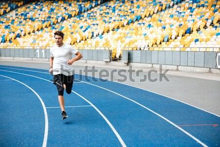 Athlete man running on a racetrack Stock photo © deandrobot