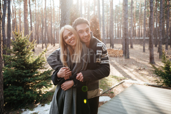 Happy loving couple standing outdoors in the forest Stock photo © deandrobot