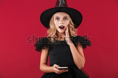 Close up image of frightening woman in halloween costume Stock photo © deandrobot