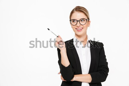 Happy blonde business woman in eyeglasses looking at the camera Stock photo © deandrobot