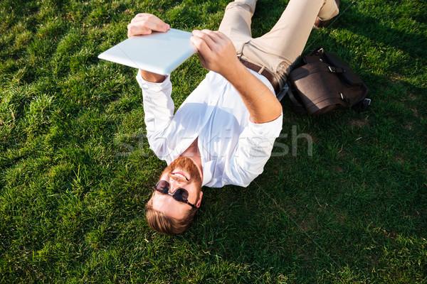 Topo ver feliz homem óculos de sol negócio Foto stock © deandrobot