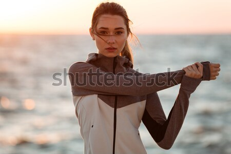 Close-up photo of beautiful brunette woman doing stretching exer Stock photo © deandrobot