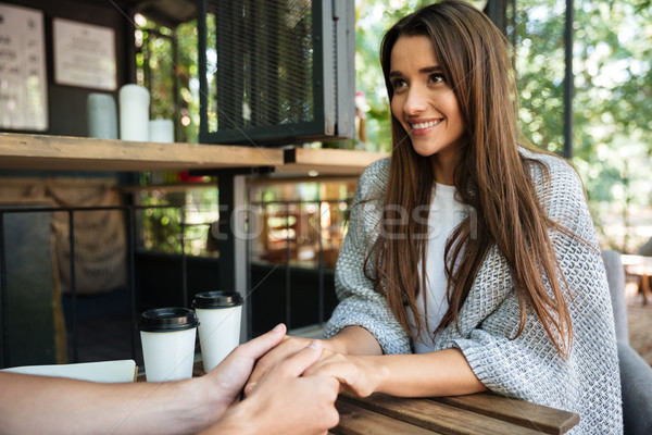 Portrait of a happy satisfied girl holding hands Stock photo © deandrobot