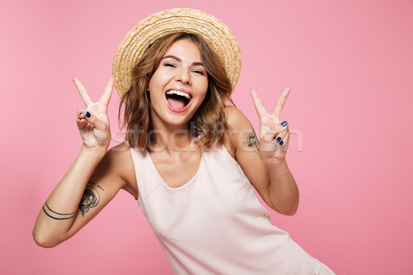 Portrait of a happy cheerful girl in summer hat Stock photo © deandrobot