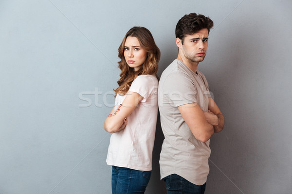 Portrait of an upset couple standing back to back Stock photo © deandrobot