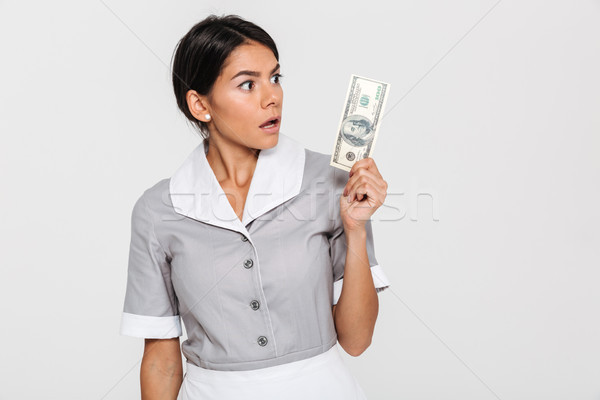 Close-up portrait of surprised young woman in uniform holding hu Stock photo © deandrobot