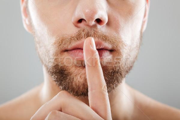 Close up portrait of half men's face Stock photo © deandrobot