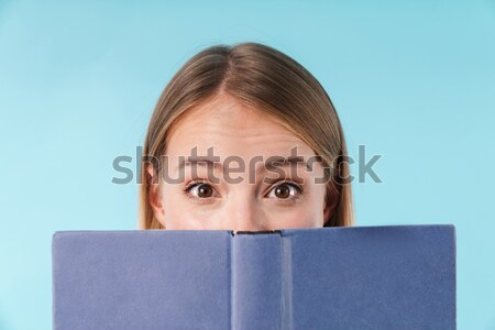 Close up portrait of a young girl covers face Stock photo © deandrobot