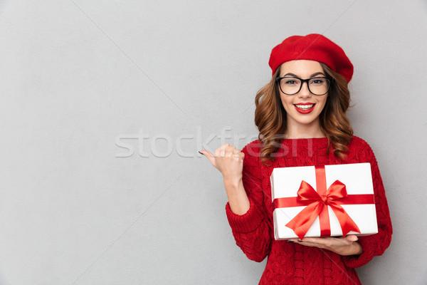 портрет улыбающаяся женщина красный свитер очки Сток-фото © deandrobot
