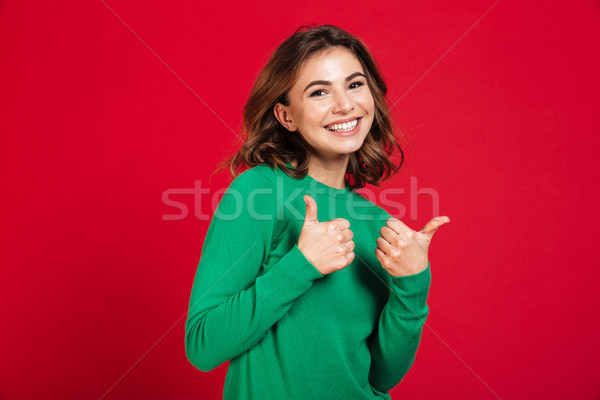 Smiling young pretty woman standing isolated Stock photo © deandrobot