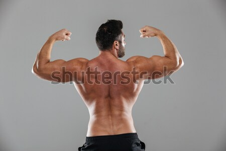 Back view portrait of a shirtless male bodybuilder Stock photo © deandrobot