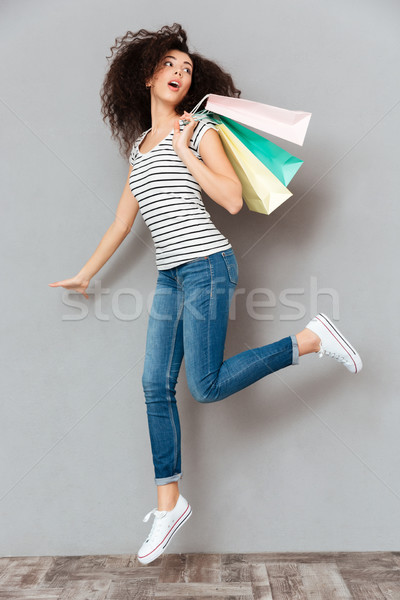 Caucasian brunette female in casual posing on camera with a lot  Stock photo © deandrobot