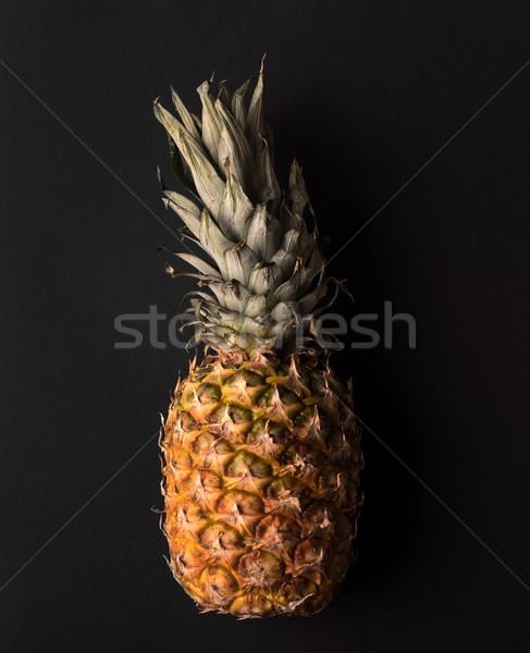 зрелый ананаса изолированный черный фрукты Сток-фото © deandrobot