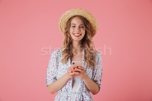 Portrait of a cheerful young woman in summer dress Stock photo © deandrobot