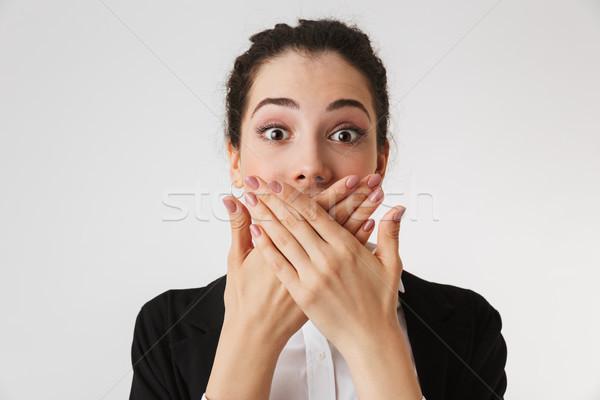 Fiatal üzletasszony befogja száját kezek kép izolált Stock fotó © deandrobot